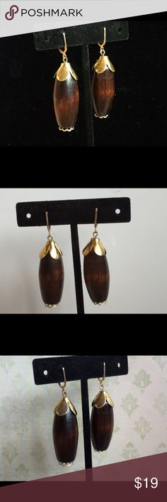 """Classic Vintage Boho Wood Pendant Dangle Earrings For your consideration are these Classic Vintage Boho Wood Pendant Dangle Earrings. Perfect for summer and you can rest assured these are authentic vintage earrings. Totally green for the consumer who values keeping our footprint """"green.""""  These measure approximately 2 inches long and 1/2"""" wide. Screw clip. Excellent condition. Jewelry Earrings"""
