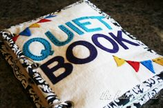 "The Quiet Book Cover. The book is held together with grommets and book binder rings. The grommet design allows more pages to be added later on. A package of Dritz 1/4"" eyelets, an eyelet tool and book binder rings from Wal-Mart for approx $5. One yard of a soft cream utility fabric for $5 plus fabric, felt and other supplies"