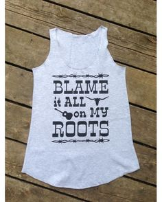 Blame it All on My Roots Tank, Jr Racer Back Flowy Tank is Durable and Comfortable in 4.5 oz. 100% combed ringspun cotton. U-neck with raw serge hem neck, armholes and bottom. Machine Washable. All shirts are designed and pressed on to each tank one at a time by Backwoods Gypsy, Clothing Co. Please allow time for your custom tank to be created and shipped. Design is cut from commercial grade t-shirt vinyl, this design is the property of Backwoods Gypsy, Clothing Co. All Rights Reserved. Our…
