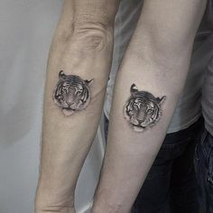 Matching tiger tattoos by Elizabeth Markov