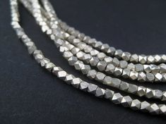 180 Tiny Diamond Cut Faceted Silver Beads 2mm  by thebeadchest