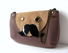 Moustache Shoulder Bag A bag with real personality! This shoulder bag is made from wool fabric in taupe and recycled nubuck leather flap in natural, patent leather moustache in black and antique brass grommet & chain for monocle. Clutch Purse, Coin Purse, Mr Mustache, Best Purses, Wool Fabric, Small Bags, Bag Making, Purses And Bags, Taupe