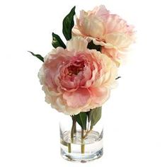 """Silk pink peony arrangement in a clear vase.Product: Faux floral arrangementConstruction Material: Silk, plastic, acrylic, and glassColor: Pink and greenFeatures: Includes faux peoniesDimensions: 13"""" H x 10"""" W x 7"""" D"""