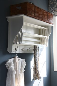 Laundry Drying Rack with Shelf & Hooks - from The Yellow Cape Cod: Laundry Room Makeover {Product Source List} Laundry Rack, Laundry Closet, Laundry In Bathroom, Laundry Hanging Rack, Wall Drying Rack, Cape Cod Bathroom, Laundry Dryer, Laundry Storage, Laundry Rooms