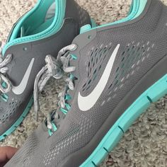 Nike free tr fit 4 Never worn nike's gray and teal Nike Shoes Athletic Shoes