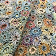 Such a beautiful pattern by, apparently, Sophie Digard. Can't find instructions anywhere but on inspection it looks like randomly sized rings of double (US: single) crochet into which chain loops (5 to 7 chains I think) are stitched and joined as you go. May try this.