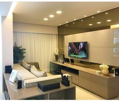 Image may contain: 1 person Tv Unit Design, Tv Wall Design, House Design, Modern Tv Units, Modern Tv Wall, Tv Cabinet Design Modern, Bedroom Tv Wall, Living Room Tv, Apartment Living