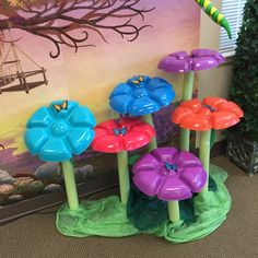 Flowers made from food trays from the dollar store and pool noodles.