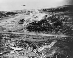 American bomber B-25 'Mitchell' Japanese bombed the airfield Clark Field (Clark Field) in the Philippines. At the bottom is visible Japanese fighter Ki-43 'Hayabusa' (Ki 43 Hayabusa). The Allies had a code name - 'Oscar