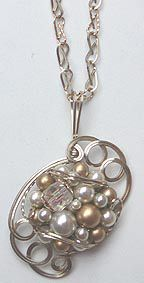 "From The Luella Collection...""Champagne Bubbles"" wire-sculpted pendant and handcrafted chain."