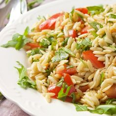 No bake orzo pasta salad filled with fresh basil, tomatoes, arugula and toasted pine nuts, perfect for those summer parties.