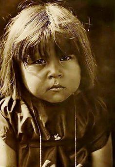 A Comanche child. Photograph by Edward Curtis, 1908.