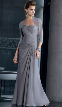 This Mori Lee VM 70510 Mother-of-the-Bride dress set features a stunning full-length chiffon gown and a sheer bolero jacket made to match. The three-quarter-sleeve bolero is made of unlined chiffon for an opaque slightly sheer look. Mother Of The Bride Gown, Mother Of Groom Dresses, Bride Groom Dress, Bride Gowns, Mothers Dresses, Mother Bride, Mob Dresses, Party Gowns, Wedding Party Dresses