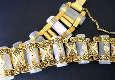 Offering a frosted glass #Damascene bracelet with book chain...vintage:  This is a unique Damascene bracelet with interesting frosted glass tubular inserts and gold tone Dam... #damascene #spain