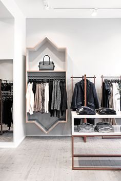 Helle Flou designed the interior for the new clothing shop Ann-L in Holbæk, Denmark. Photos by Kristine Funch.