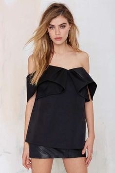 This structured black top by Cameo is perfect for anything from the boardroom to the dance floor--it's one of those pieces that's perfect for any occasion.