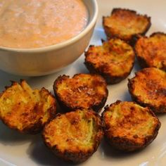 Zucchini Tots-1 cup shredded, peeled zucchini (about 2 zucchinis) 1 small onion, diced 1 egg 1/4 Italian seasoned bread crumbs 1 teaspoon garlic powder 1 teaspoon seasoned salt 1/2 teaspoon black pepper 1/2 cup shredded cheddar cheese
