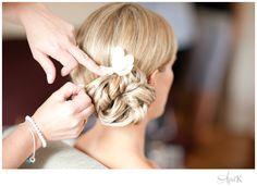 Low side bun with flower Boston Wedding photographer aprilkphoto.com