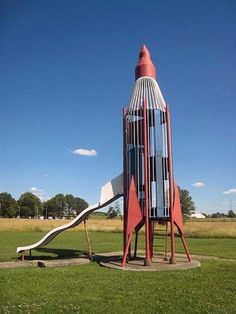 I'm pretty sure a park near me had this rocket slide when I was younger.    This reminds me exactly of my favorite poem: Secret Playdate by Kristina Lucenko   http://www.mamazine.com/Pages/poetry_poem99_start30.html