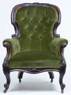 19th Century Victorian Carved Dark Walnut Lounge Chair. Yep.  That's my taste In furniture summed up.