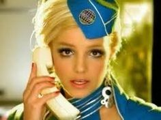 Brittany as a flight attendant in a video