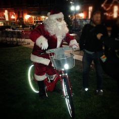 Santa is out and about on a #candycaneredbike for Light Up OTR! #cincyredbike