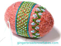 Trellis and chevron stitches on a felted easter egg