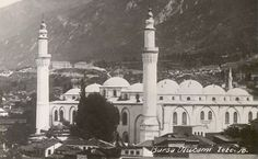 Bursa Ulu Cami, Exterior view from northwest, showing plastered exterior of mosque which was stripped to reveal the limestone façades in 1959   Archnet