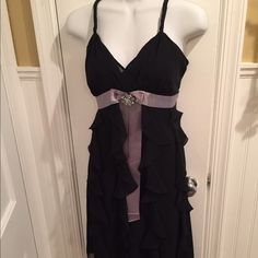 """Black ruffle dress About 37"""" long. Comes with grey slip that matches the bow color. Grey ribbon and bow with embellishment. Ruffled down the dress. Clues Dresses"""
