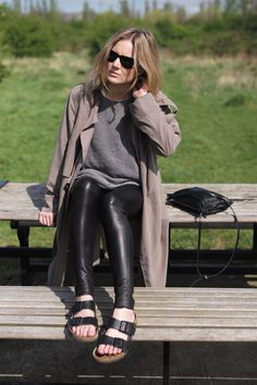 """Blogger Lucy Williams from """"Fashion Me Now""""   Trench coat (Zara). Jumper (Gap). Leather leggings (Alice & Olivia). Sandals (Birkenstock). Sunglasses (Ray-Ban). Bag (COS). Necklaces (Lumo)."""