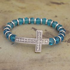 Aqua Sideways Cross Stretch Bracelet, $9.98 // Add some color and faith to your wardrobe.