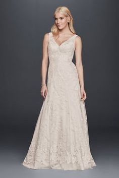 The illusion tank straps and beaded lace appliques on this tulle A-line wedding dress contribute a feminine quality to the classic and supremely flattering silhouette.  David's Bridal Collection  Polyester  Sweep train  Back zipper; fully lined  Dry clean  Imported