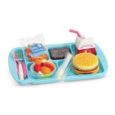 When the lunch bell rings, her Truly Me™ doll can enjoy a yummy meal in the school cafeteria. This set includes a blue lunch tray with sections to hold her make-believe food: •A cheeseburger with lett
