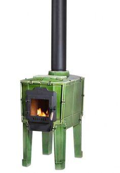 Dutch designer Dick van Hoff presented wood-burning stoves made of tiles for Dutch ceramic manufacturers Royal Tichelaar Makkum Small Fireplace, Stove Fireplace, Foyers, Ceramic Manufacturer, Small Tub, Tile Saw, Corten Steel, Wood Burner, Herd