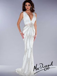 This chiffon Mac Duggal 81885P pageant dress features a deep V-neckline, ruched bust and thick straps, and unique keyhole spider back. Completing this Mac Duggal pageant dress is a slim floor length skirt with a train.