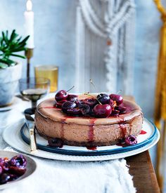 Desserts in the '70s were all about Black Forest cake and cheesecakes. We figured a combination of the two could only be a good thing. Instead of the cornflour thickened fruit topping of earlier eras, we've opted for lush roast cherries. This can be made well in advance, so it's the entertainer's friend.
