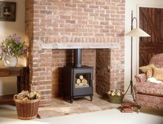 Morsø stoves delivers a comforting heat in the center of your home. Experience the crackling of fire with our beautiful indoor heating stoves. Log Burner Living Room, Log Burner Fireplace, Wood Burner, Brick Fireplace, Fireplace Ideas, Wood Stove Decor, Lounge Design, Basement Remodeling, Living Room Decor