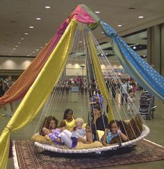 Children love a Floating Bed -decorate with yards of colorful cloth for a festive or party touch