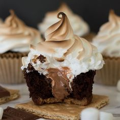 Perfect s'mores cupcakes: graham cracker base, decadent chocolate cake, gooey Hershey's chocolate buttercream center, and toasted marshmallow frosting.