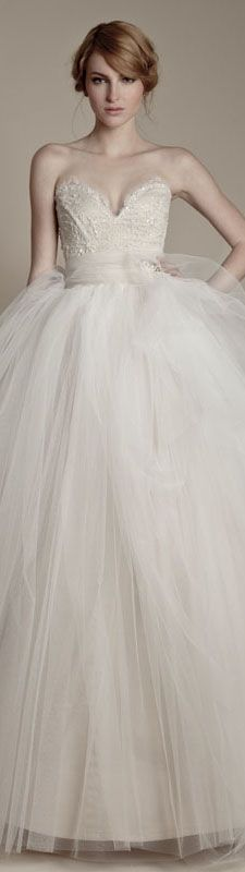 Ersa Atelier 2013 ball gown wedding dress with no straps, sweetheart neckline, heavily sequined bodice, natural waist with sash, and dramatic tulle skirt.