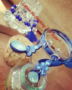 Orecchini blu e bracciale con nappa strass e pietre