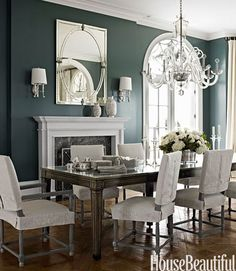 Mix and Chic: Dining Room with fireplace//beautiful wall colors that make this beautiful table pop...luxury
