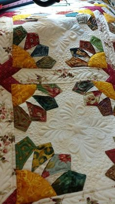 Looking for quilting project inspiration? Check out Golden Dresden Bloom by member intuitive1377015.