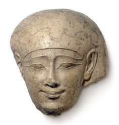 Egyptian Limestone Head from a Sarcophagus Lid  - Late Ptolemaic Period, circa 3rd or 4th Century BC