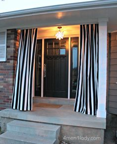 Interesting front porch light - even more interesting to put curtains on the front porch