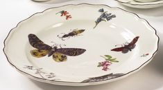 A Chelsea plate circa 1755 painted with colorful butterflies, a beetle and scattered flower sprigs, red anchor mark. diameter 9 1/8 in Hammer price with Premium $6,000