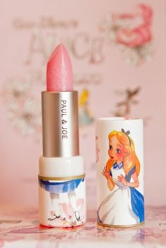 alice in wonderland vintage look pale shimmer pink lipstick by paul & joe  <3 I'm not brave enough for lipstick, but I would buy this for the alice anyway.