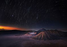 The great three vulcanoes; Mt.Bromo(middle-active with faint smoke) ,Batok(front,completely inactive) and Sumeru(intermittently active,back) taken from Pinajagun II view point. surabaya Indonesia   Star trails processed from actual stars at the exact location.. by Weerapong Chaipuck