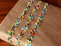 """confetti on double sided tape. especially because i want to do only """"brown paper packages tied up with string"""" for wrapping paper this year. Craft Gifts, Diy Gifts, Diy Confetti, Paper Confetti, Diy Cadeau, Brown Paper Packages, Pretty Packaging, Packaging Ideas, Paper Packaging"""