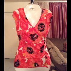 """Ann Taylor Top Ann Taylor Top is made of 95% Cotton and 5% Spandex. Size Petite Small. Colors are: black/white/pink/yellow/red. Top stretches. The Length """"24. Laying flat """"15. Ann Taylor Tops"""